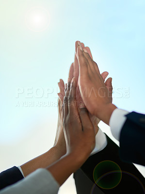 Buy stock photo Cropped shot of a group of businesspeople giving each other a high five outdoors