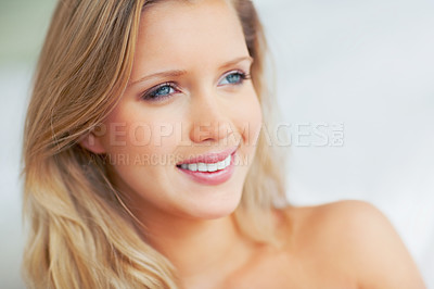 Buy stock photo Closeup of an attractive young woman smiling