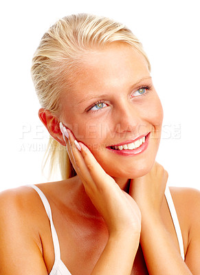 Buy stock photo Happy young woman touching face over white background , looking away