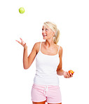 Beautiful woman tossing an apple over white background