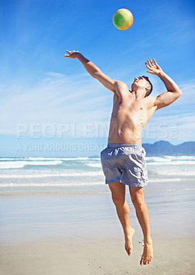 Buy stock photo Shot of a beach volleyball game on a sunny day