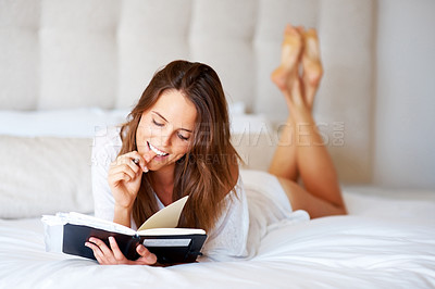 Buy stock photo Happy young woman with a pen and diary