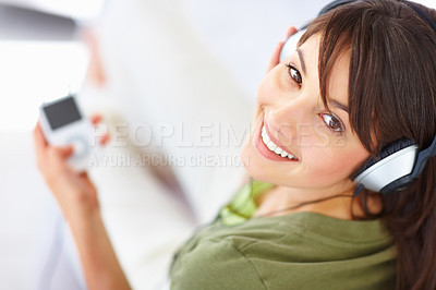 Buy stock photo Lovely woman listening to music