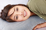 Lovely woman lying on a pillow