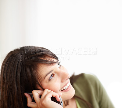 Buy stock photo Happy young woman looking at copyspace talking on t