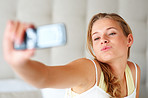 Self photography - Young woman taking her picture