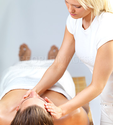Buy stock photo Beautiful blond woman giving man a facial massage at the day spa. Part of a healthy holiday