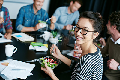 Buy stock photo Portrait of a young office worker  eating lunch with coworkers at a boardroom table
