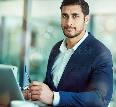 Buy stock photo Portrait of an executive working on a laptop in an office