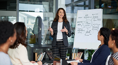 Buy stock photo Shot of an attractive young businesswoman giving a presentation in the boardroom