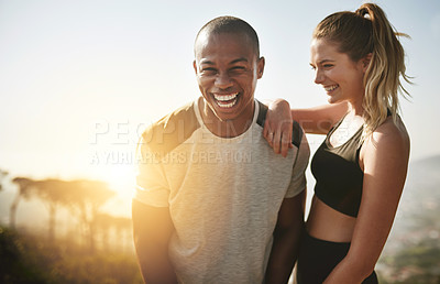 Buy stock photo Shot of a fit young couple working out together outdoors