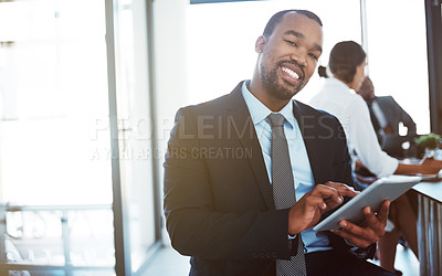 Buy stock photo Portrait of a happy young businessman using a digital tablet during a meeting at work