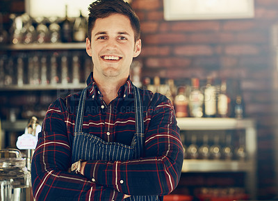 Buy stock photo Portrait of a smiling young entrepreneur standing in a small restaurant
