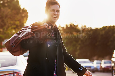 Buy stock photo Portrait of a handsome young man taking a walk through the city