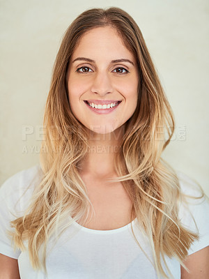 Buy stock photo Portrait of an attractive young woman smiling in studio