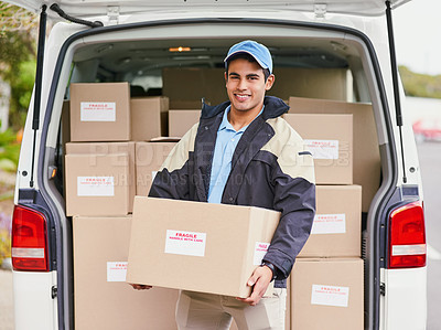 Buy stock photo Portrait of a delivery man unloading boxes from his van