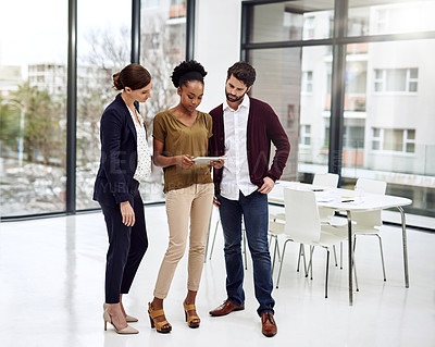 Buy stock photo Cropped shot of businesspeople discussing something on a digital tablet