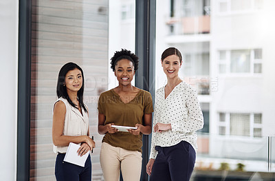 Buy stock photo Cropped portrait of a group of businesswomen standing together in a modern office