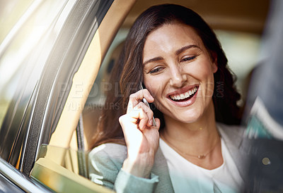 Buy stock photo Shot of a beautiful businesswoman talking on her phone while traveling by car