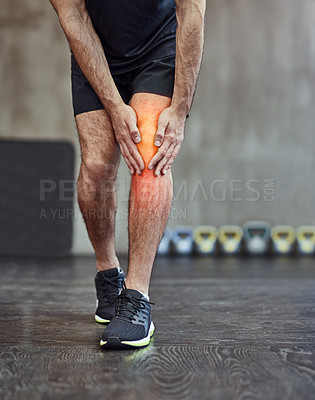 Buy stock photo Shot of an unrecognizable man holding his knee in pain