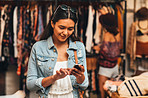 Sharing her shopping experience with her social network