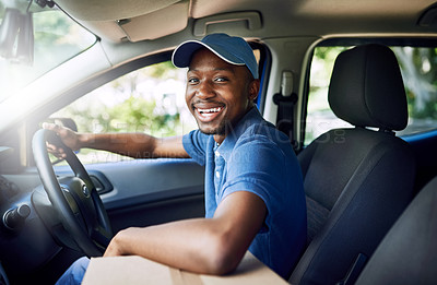Buy stock photo Portrait of a young postal working sitting in his car during a delivery