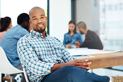 Buy stock photo Portrait of a handsome young man sitting in the boardroom during a meeting