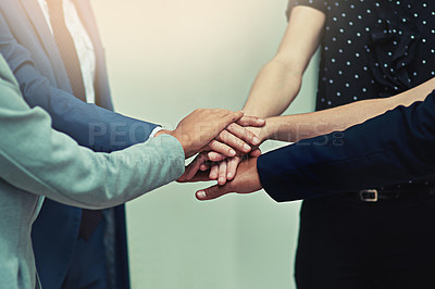 Buy stock photo Cropped shot of a group of unrecognisable businesspeople joining their hands together in unity