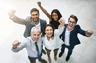 Buy stock photo High angle portrait of a diverse team of professionals cheering at work