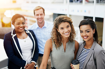 Buy stock photo Portrait of a group of smiling businesspeople standing together in a modern office