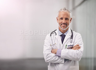 Buy stock photo Portrait of a mature male doctor standing in a hospital