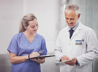Buy stock photo Cropped shot of two medical practitioners having a discussion in a hospital