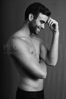 Buy stock photo Black and white shot of a handsome young man posing with his top off