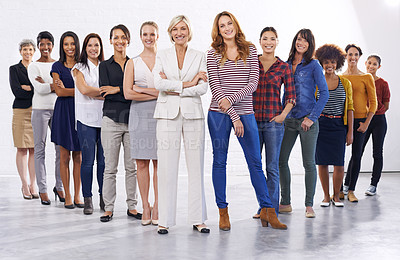 Buy stock photo Full length studio of a group of happy people half wearing casual clothes and half wearing formal clothes