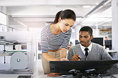 Buy stock photo Shot of two colleagues talking together over a touchscreen computer while working with a 3d printer