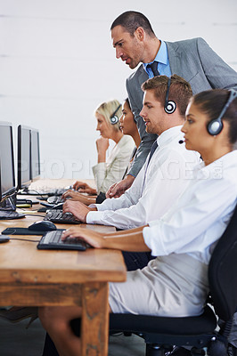 Buy stock photo Cropped shot of a people working in a call center