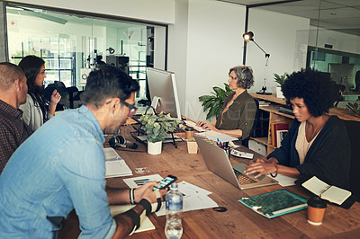 Buy stock photo Cropped shot of a group of businesspeople working in an office