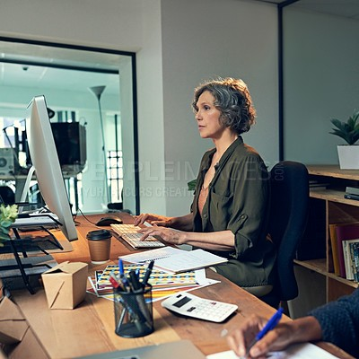 Buy stock photo Cropped shot of a mature businesswomen working on a computer in an office