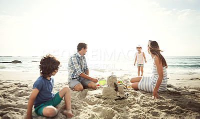 Buy stock photo Shot of a family relaxing on the beach together