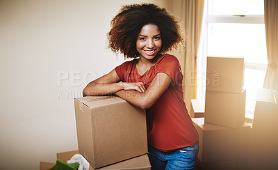 Buy stock photo Portrait of a young woman moving into her new home