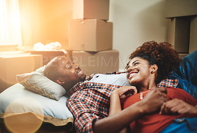Buy stock photo Cropped shot of a young couple taking a break while moving into their new home