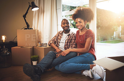 Buy stock photo Portrait of a young couple taking a break while moving into their new home