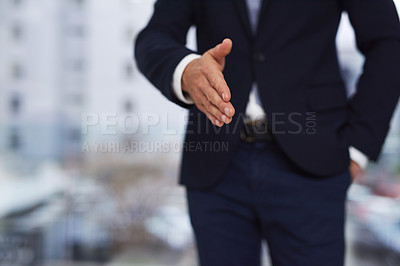 Buy stock photo Cropped shot of a businessman standing outside extending a handshake