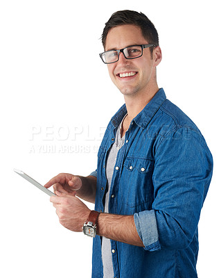 Buy stock photo Studio portrait of a handsome young man holding a digital tablet isolated on white