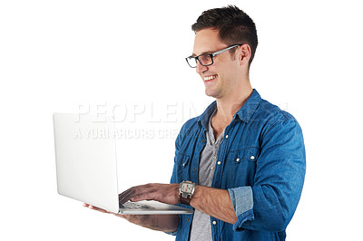 Buy stock photo Studio shot of a handsome young man holding a laptop isolated on white