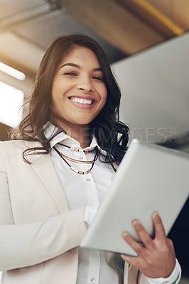 Buy stock photo Portrait of a young businesswoman working on a digital table in an office