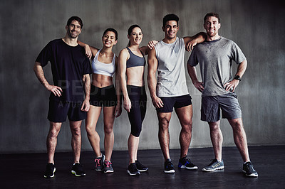 Buy stock photo Portrait of a group of fit young people standing together at the gym
