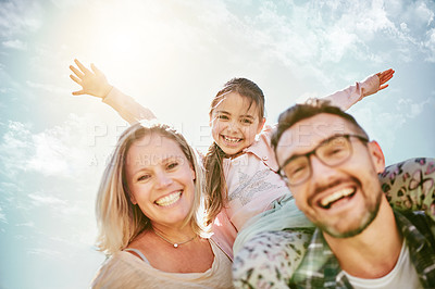 Buy stock photo Portrait of a happy young family having fun outdoors