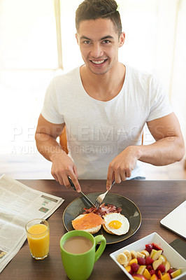 Buy stock photo Cropped shot of a bachelor enjoying breakfast at home