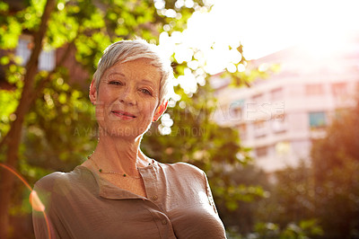 Buy stock photo Portrait of an attractive mature woman standing outside in the city